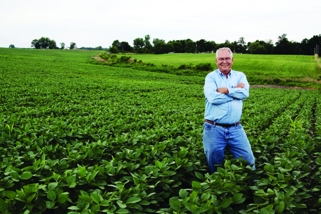 Farmer posing with his crops